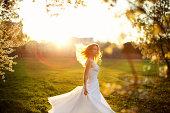 Woman in Wedding Dress in Park