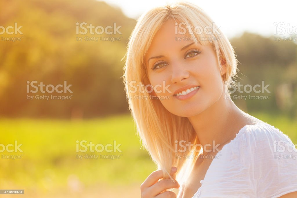 Woman in wheat field enjoying beautiful summer day royalty-free stock photo
