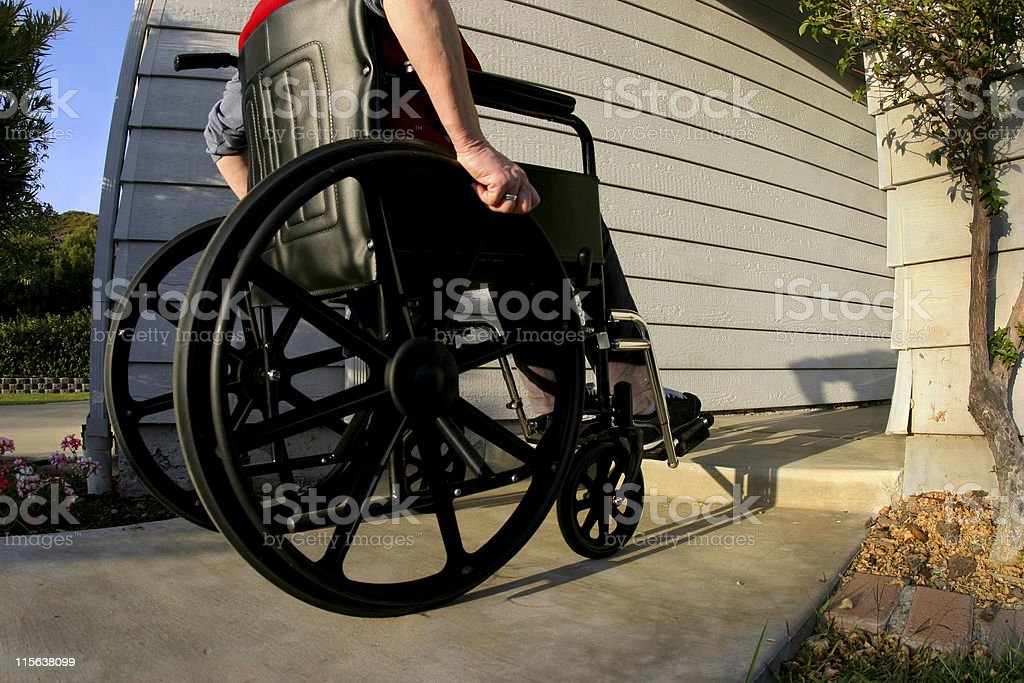 Woman in wheelchair 1 Woman in a wheelchair with a step to overcome  Adult Stock Photo