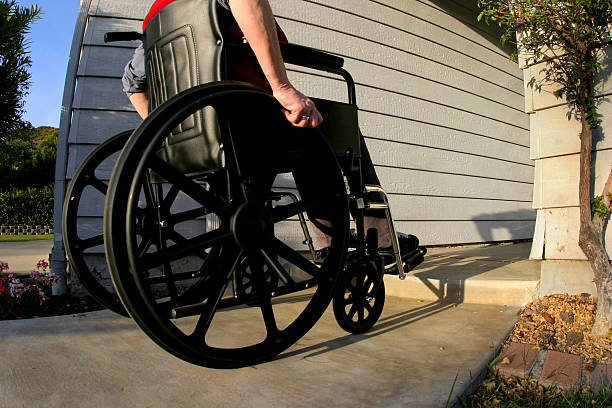 Woman in wheelchair 1 stock photo