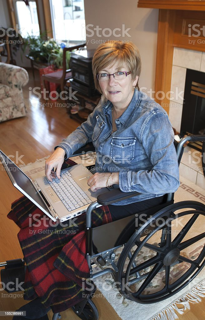 Woman in wheelchair: Assisted Living stock photo
