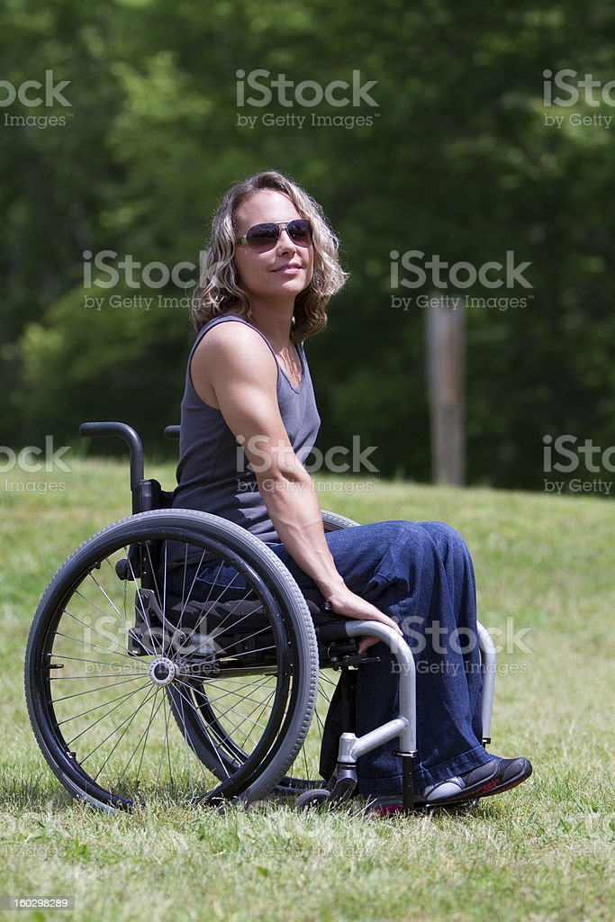 Woman in Wheelchair, Outdoors royalty-free stock photo
