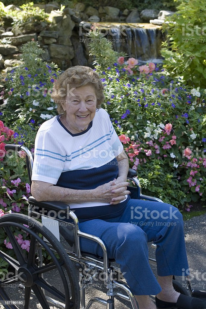 Woman in wheelchair royalty-free stock photo