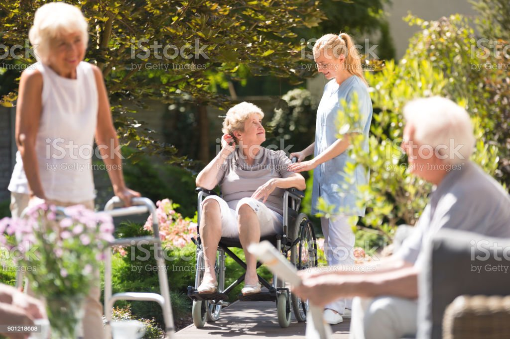 Woman in wheelchair stock photo