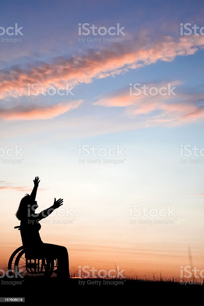 Woman In Wheelchair Reaching For Heaven royalty-free stock photo