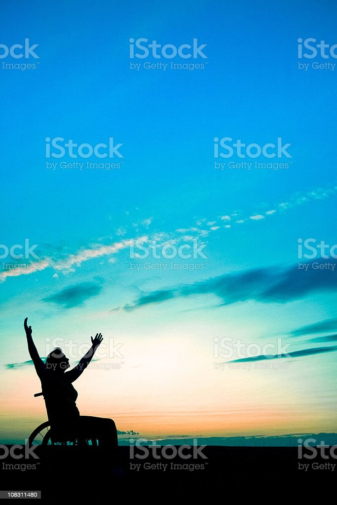 Woman In Wheelchair Reaching For Sky And Heavens royalty-free stock photo