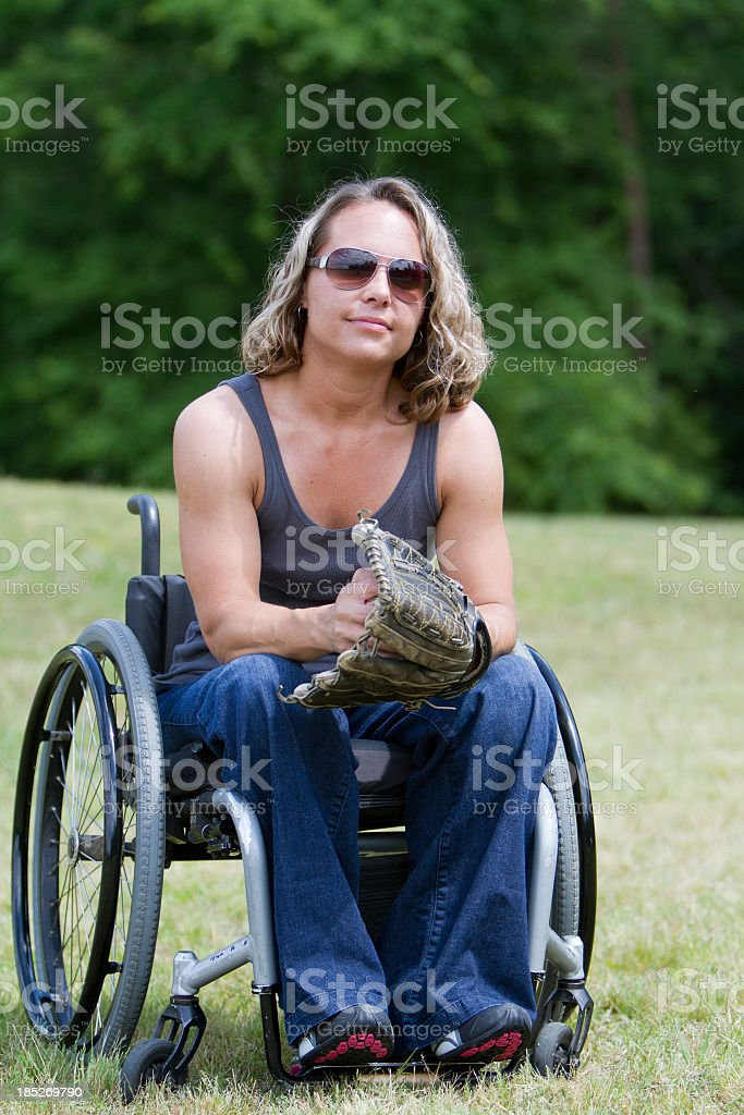 Woman in Wheelchair with Baseball Glove stock photo