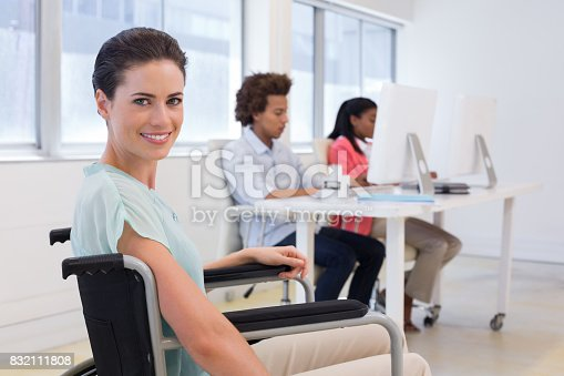 660681964istockphoto Woman in wheelchair working hard 832111808