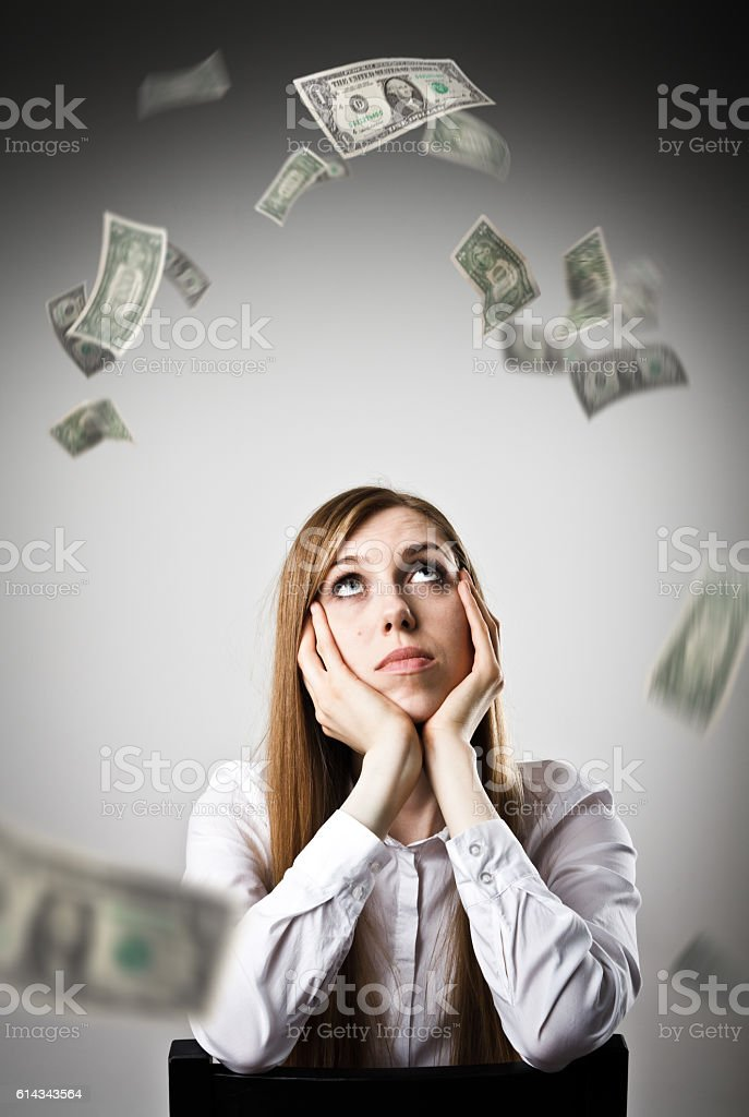 Woman in white and DOLLARS. stock photo