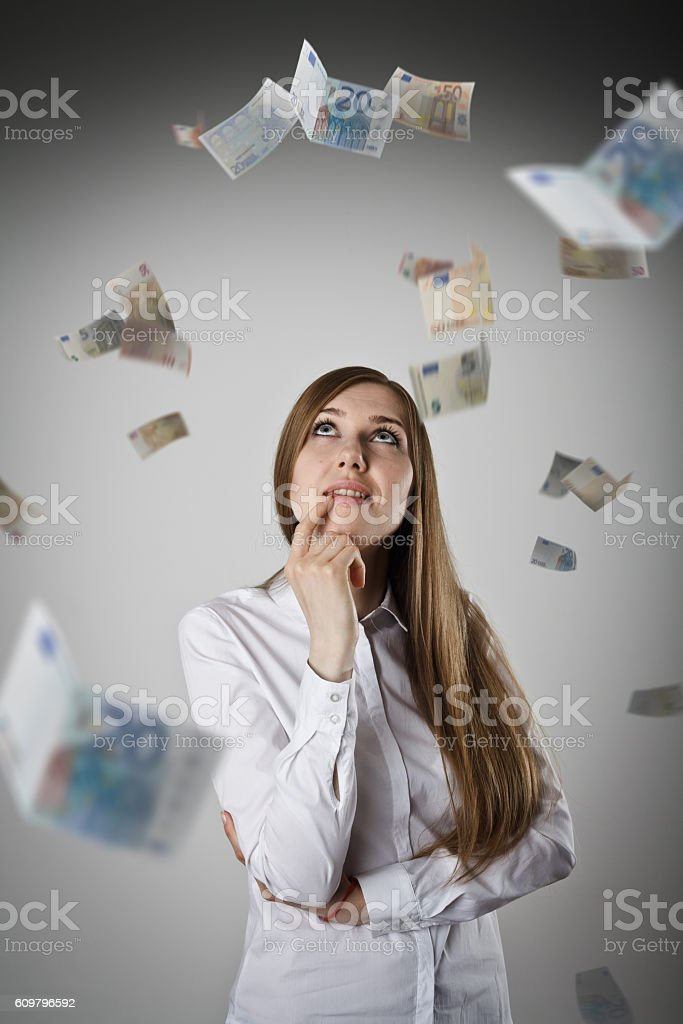 Woman in white and Euro. stock photo