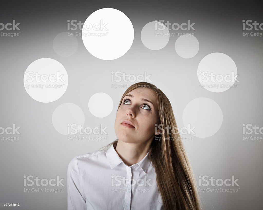 Woman in white and gray bubbles. royalty-free stock photo