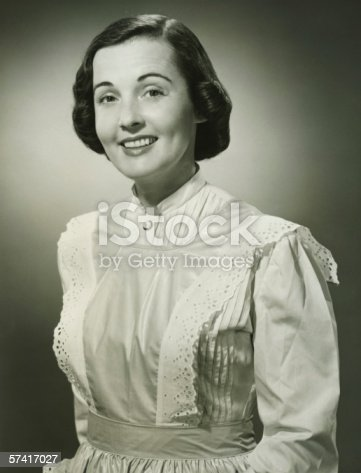 istock Woman in white apron posing in studio, (B&W), (Portrait) 57417027