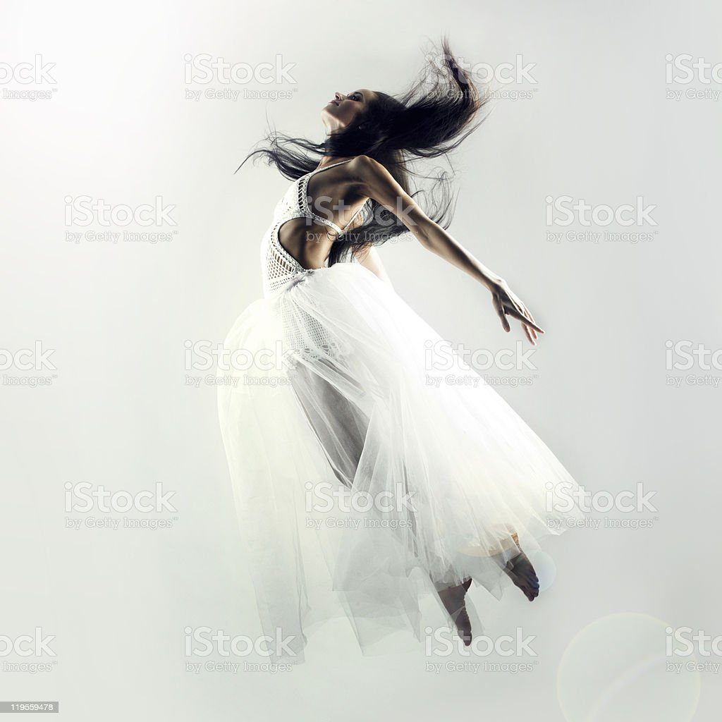 Woman in white dress flying on white background stock photo