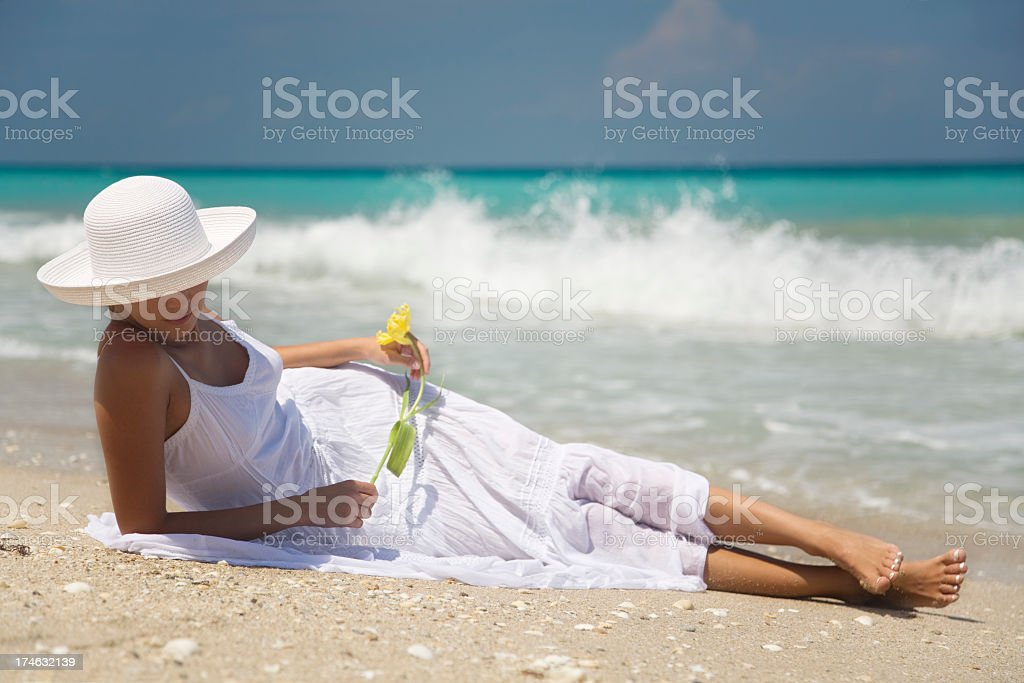woman in white dress with flower stock photo