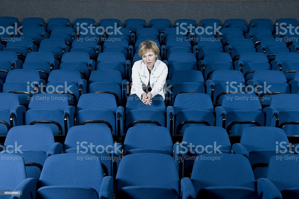 Woman in White Leather Blue Seats royalty-free stock photo