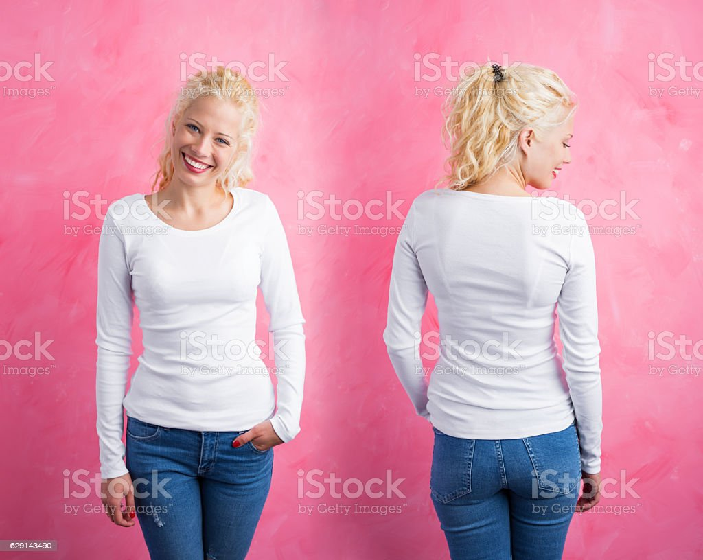 Woman in white long sleeve shirt on pink background stock photo