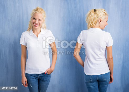 istock Woman in white polo T-shirt on blue background 629144764