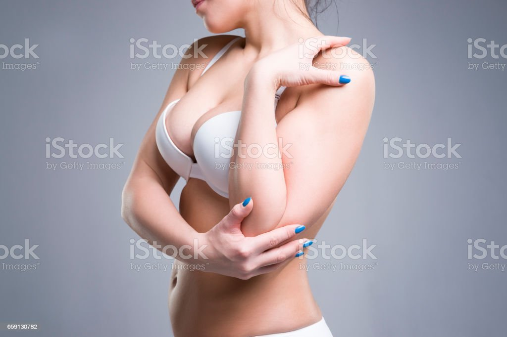 Woman in white push up bra, perfect female breast stock photo