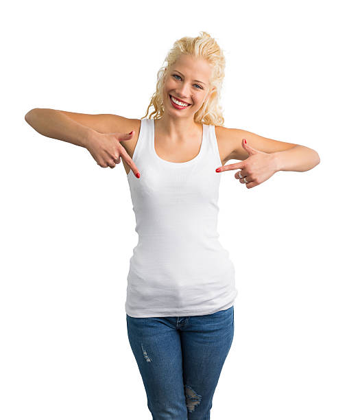 Woman in white tank-top pointing at it stock photo