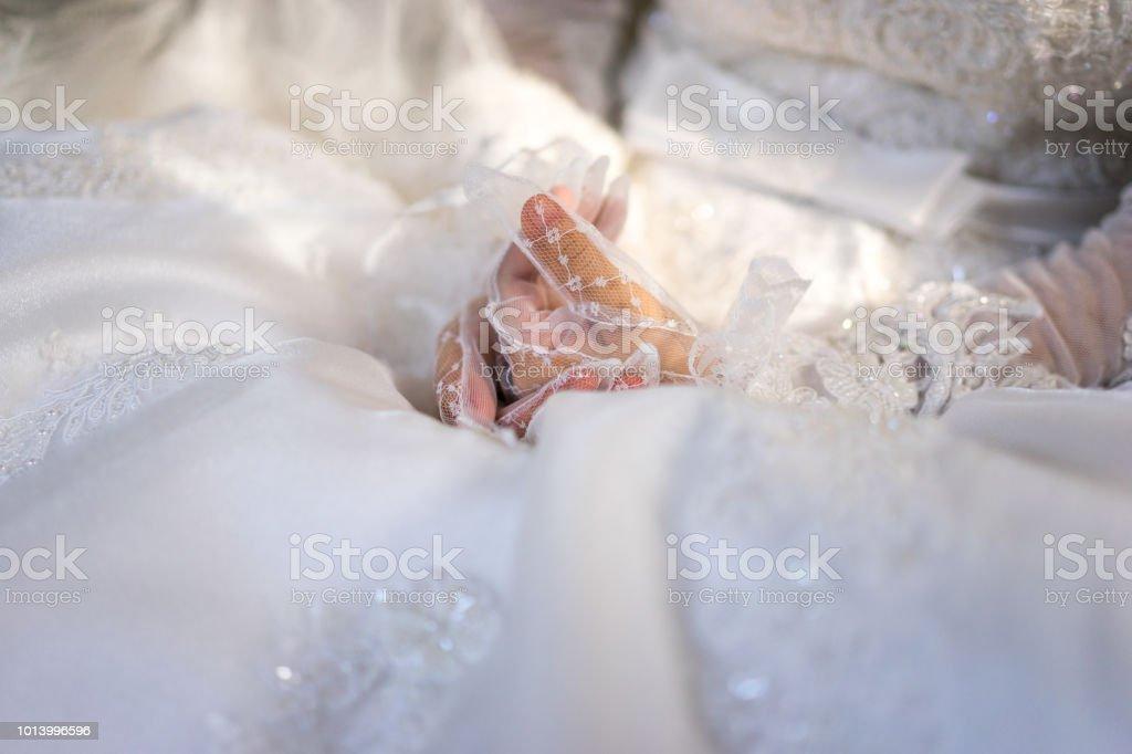 Woman In White Wedding Dress Bride Hands In White Bride Gloves