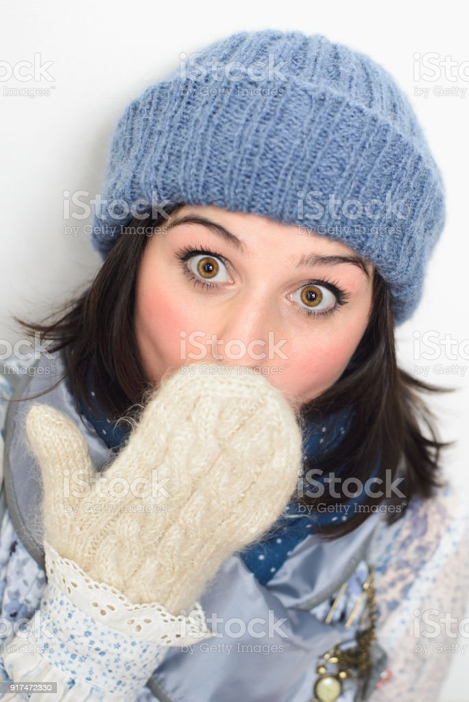 woman in winter clothes on white background stock photo