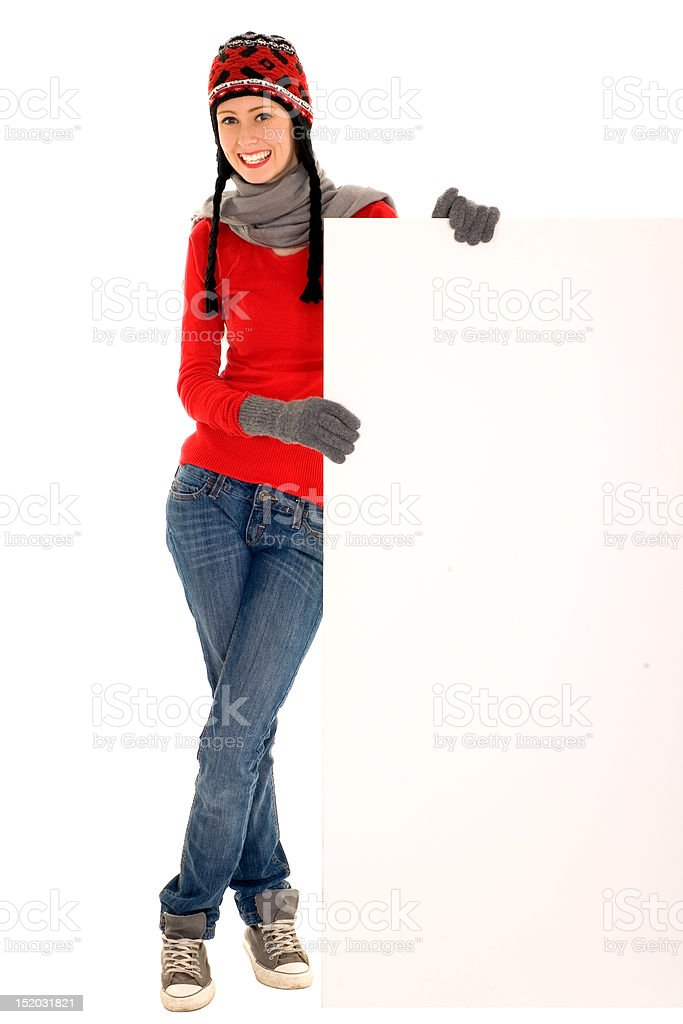 Woman in winter clothing holding a billboard royalty-free stock photo