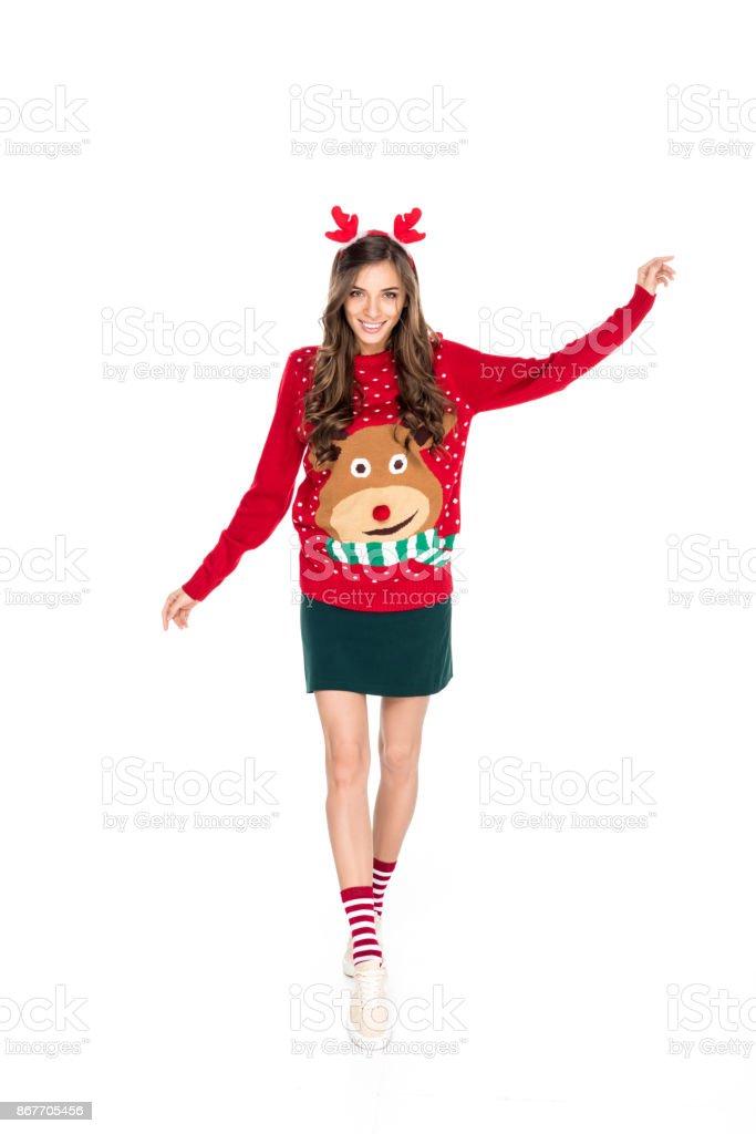 woman in winter festive sweater stock photo