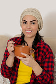 woman in winter outfit taking broth