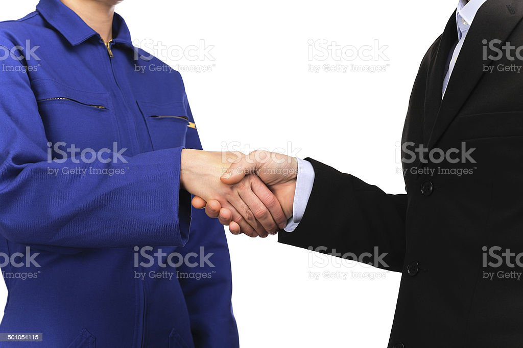 woman in work uniform and a man shaking hands stock photo