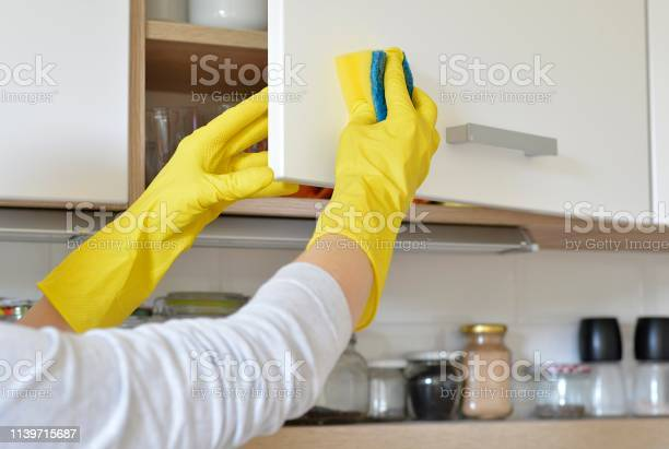 Woman in yellow gloves washes the door in kitchen cabinet picture id1139715687?b=1&k=6&m=1139715687&s=612x612&h= kfmafjner6dxyhvxpol9cd035orhsfu8fpadkyfvpa=
