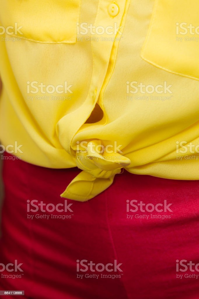 woman in yellow knotted shirt closeup royalty-free stock photo