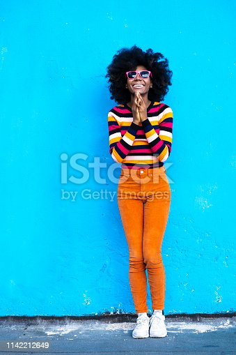istock Woman in yellow vest,headphones and sunglasses 1142212649