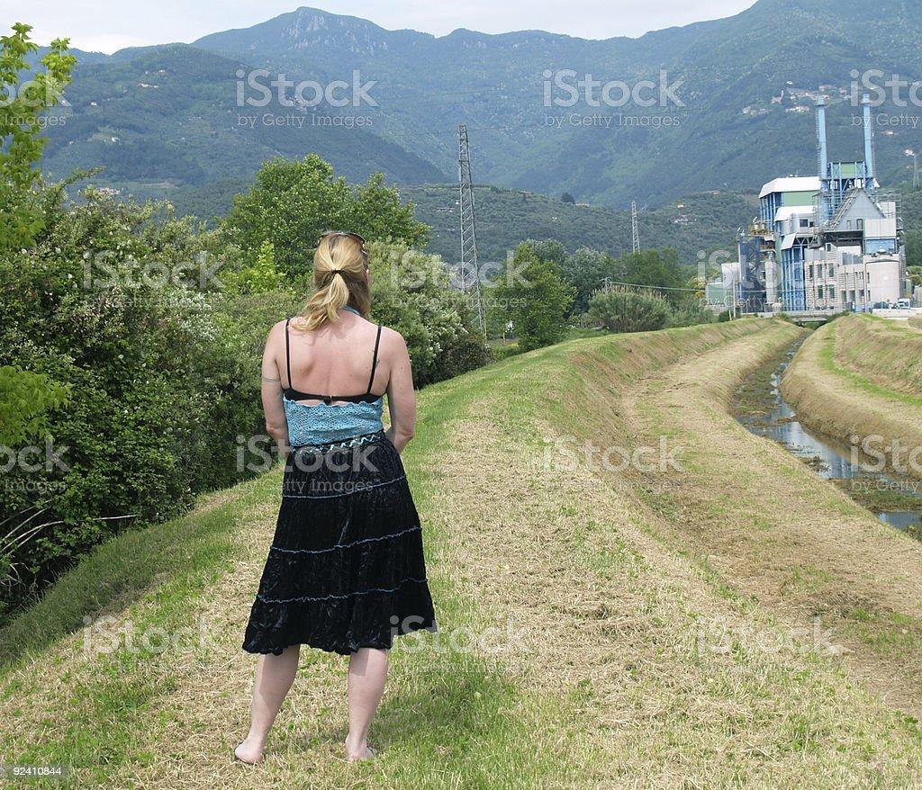 Woman & Incinerator royalty-free stock photo