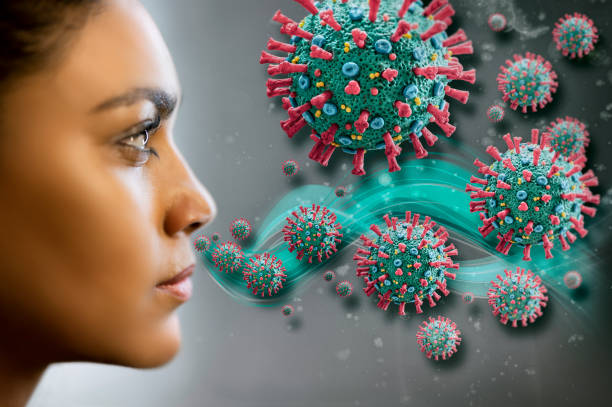 Woman inhaling corona virus COVID-19 Woman inhaling corona virus COVID-19. The image is a scientific interpretation of the virus with all relevant details : Spike Glycoproteins, Hemagglutinin-esterase, E- and M-Proteins and Envelope. glycoprotein stock pictures, royalty-free photos & images