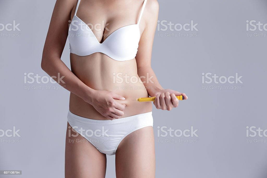 woman inject drugs on waist stock photo