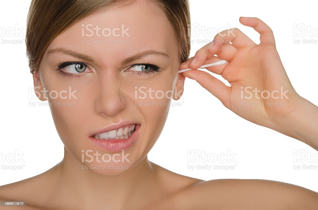 woman injured cleans ears with cotton sticks stock photo