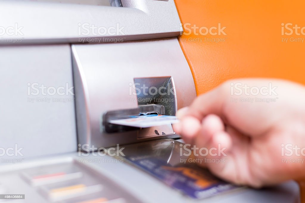 Woman Insert Credit Card at ATM. Cash machine stock photo