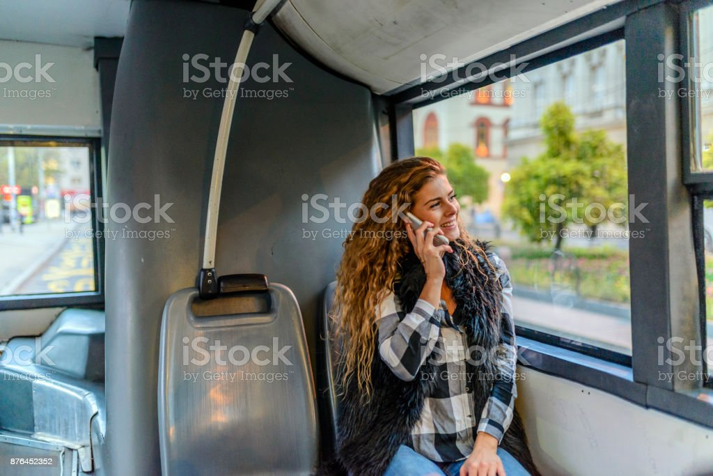 Woman inside a bus  on the phone stock photo