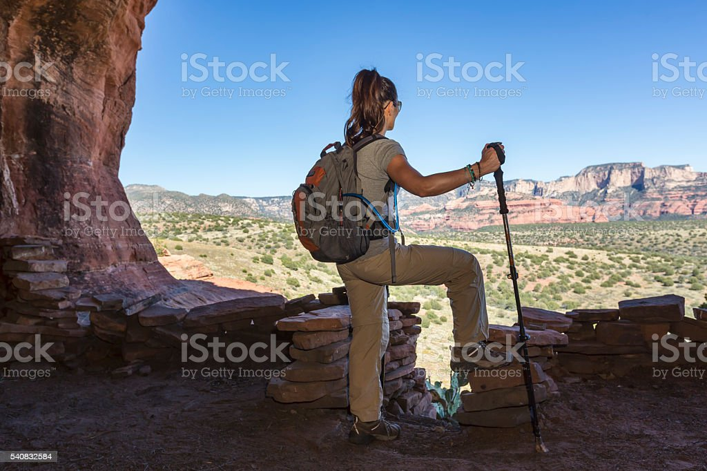 Woman Inside Cave Viewing The Landscape stock photo