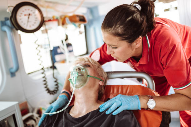 woman inside the ambulance - paramedic stock pictures, royalty-free photos & images