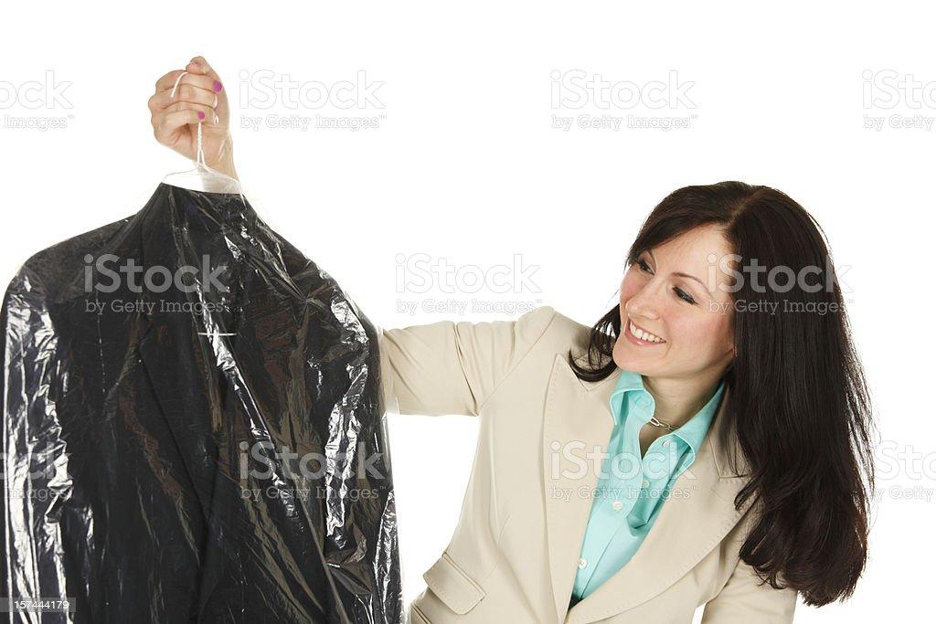 Woman Inspecting Blazer royalty-free stock photo
