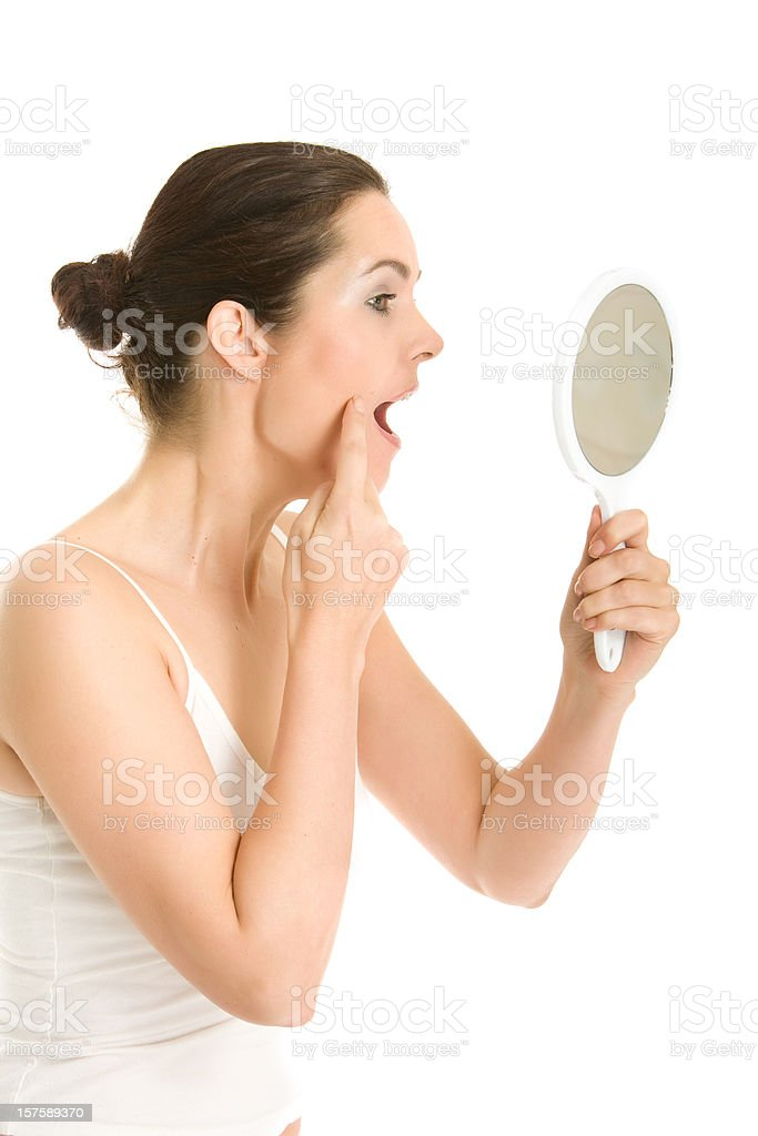Woman inspecting her skin royalty-free stock photo