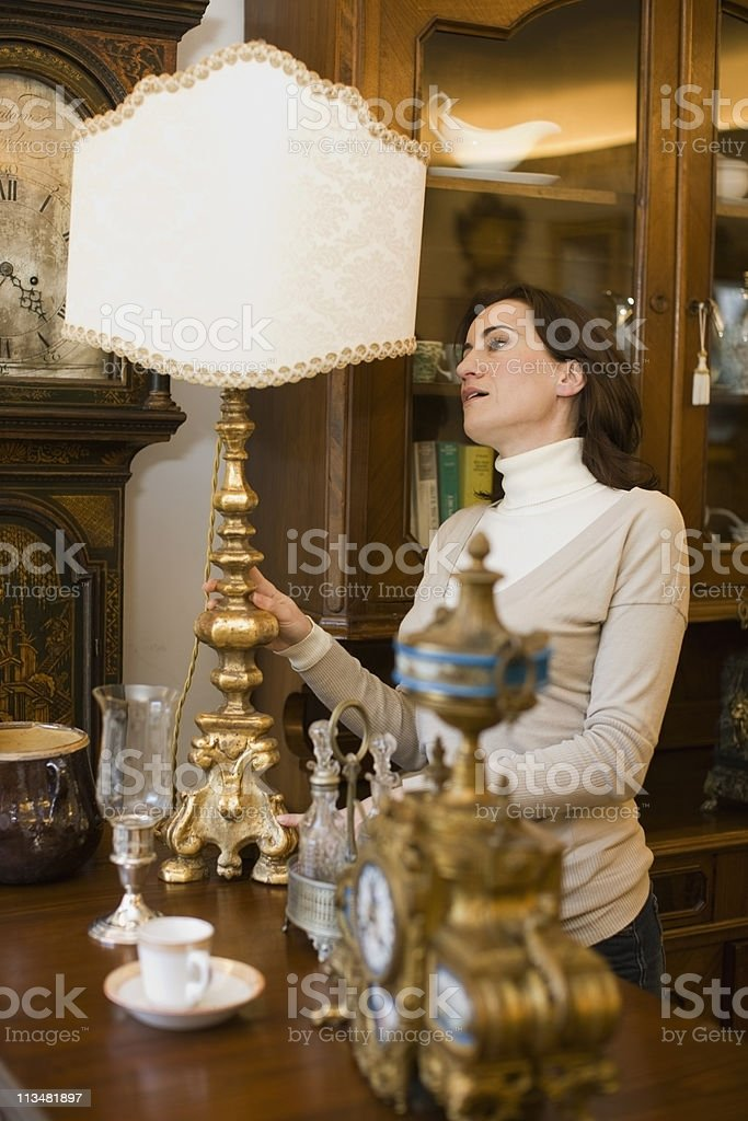 Woman inspecting products on offer stock photo