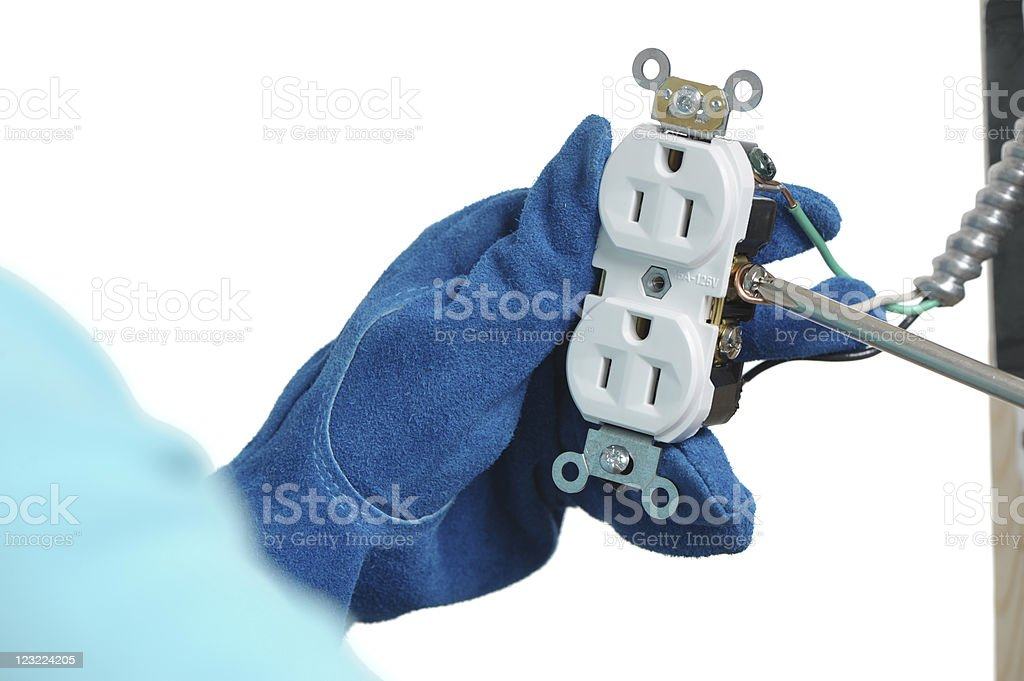 Woman Installing an Electrical Outlet with Screwdriver on White royalty-free stock photo