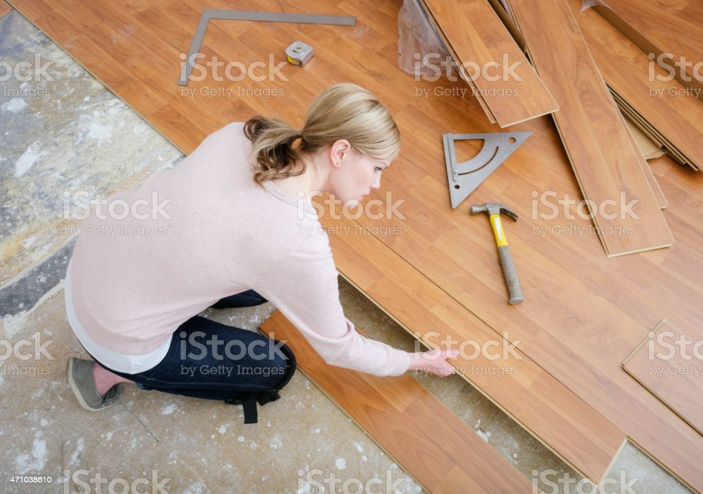 Woman Installing Laminate Flooring Stock Photo More Pictures Of