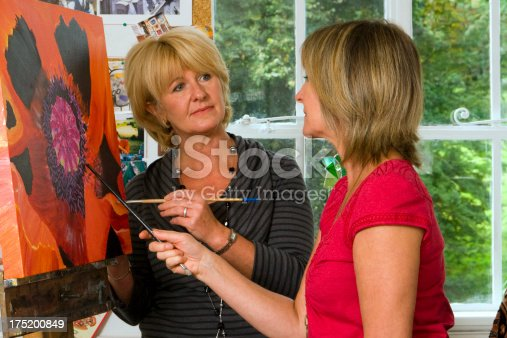 istock Woman instructing student in a fine arts class 175200849