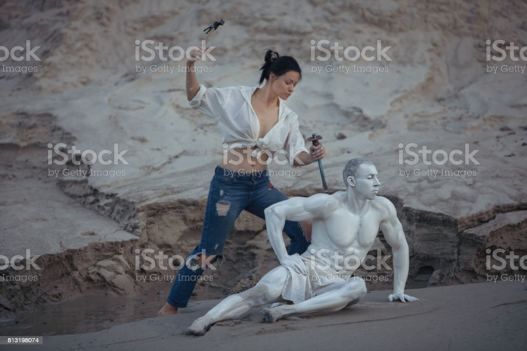 Woman is a master sculptor. stock photo