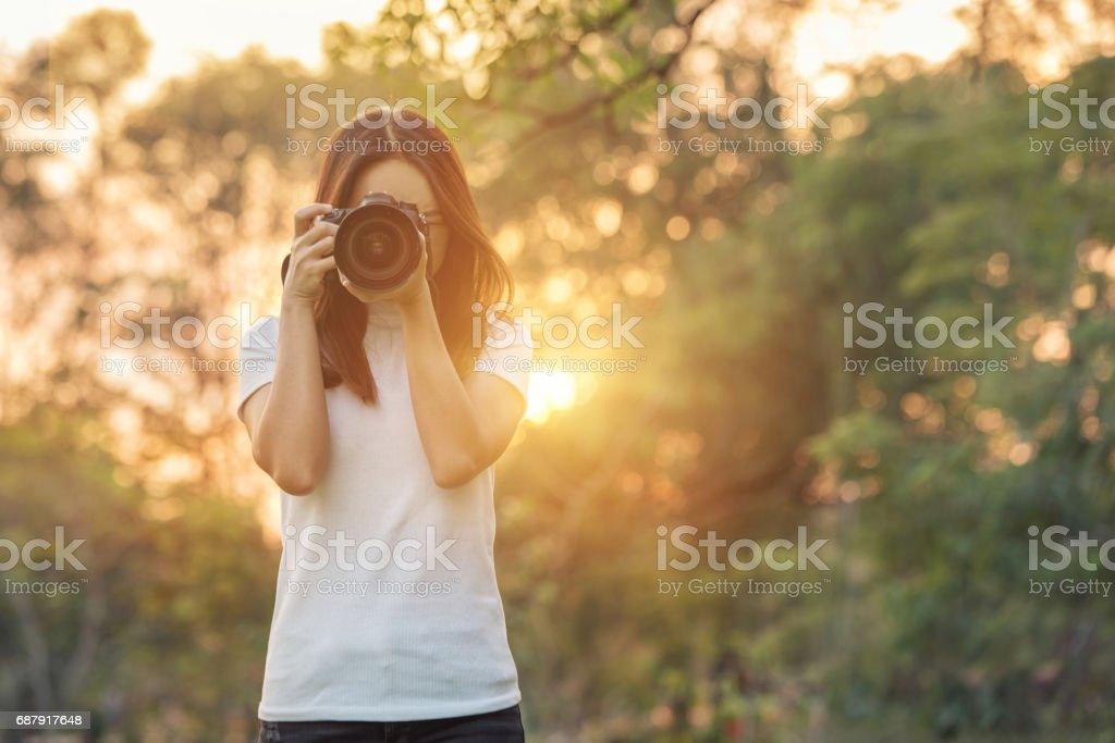 Woman is a professional photographer with dslr camera stock photo
