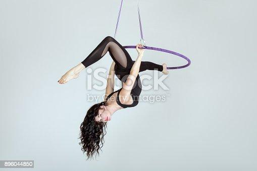 istock Woman is an acrobat in a hula hoopa. 896044850