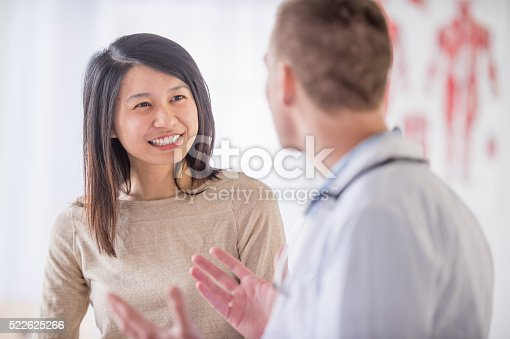 522625266istockphoto A woman is at the doctor's office and is getting good 522625266